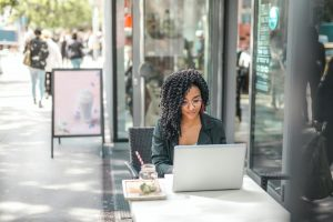 woman sitting at a computer outside